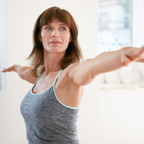 mid-aged woman with endometriosis is exercising